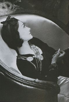 Gabrielle 'Coco' Chanel (55) - 1938 .//gorgeous vintage black&white photograph of the infamous&beautiful Coco Chanel, lounging in her luxurious chair - perfectly accesorized