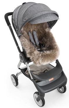Stokke Stroller Sheepskin Lining. Pure sheepskin has a natural breathing quality that helps to maintain a steady body temperature for your little one in all types of weather. Baby Necessities, Baby Essentials, Dream Baby, Baby Cover, Baby Education, Twin Babies, Baby Boys, Baby Carriage, Baby Safety