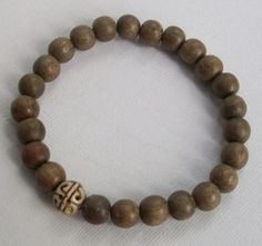 How to carefor wood bracelets - shown Mens Bracelet in Wood