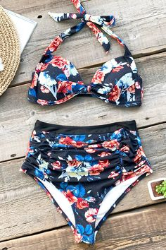 610db0911cb59 This bikini features moulded cup for support with halter ties for the  perfect fit. High waisted bottom with ruching for flattering tummy coverage.