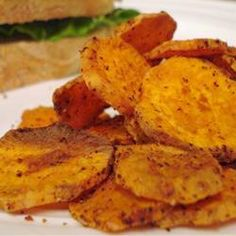 Spicy Sweet Potato Chips Allrecipes.com   Original recipe makes 3 cups   Ingredients:  2 tablespoons olive oil   2 tablespoons maple syrup   1/4 teaspoon cayenne pepper   3 large sweet potato, peeled and cut into 1/4-inch slices