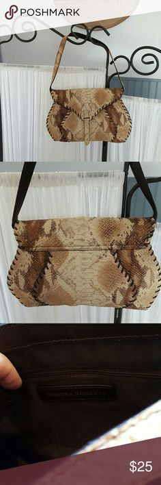 """SONDRA ROBERTS SNAKESKIN BAG 12"""" x9"""" Tan/brown/vream textured snakeskin Brown outer stitching Magnetic snap flap front 9"""" strap hang Inside is roomy and organized. 1large zippered middle pocket, small zippered pocket, 2 sleeve pockets. Lined with brown ribbed sateen. Inside and out is pristine condition. Like new sondra roberts Bags"""