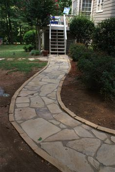 Demolish current front walkway and put in a limestone walkway that curves across the yard toward the driveway. Not a winding curve as shown in this picture...more of a simple curve.