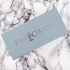 Printers Pick Of The Week #PPOTW   Fine & Country use our small steel blue snapshut boxes with a classic silver foil print, very classy.
