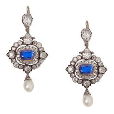 Exquisite Victorian pendant earrings, all original. Each earring is backed in 15 karat gold, topped in silver and centers 1 NON-HEAT TREATED (with AGL certificates) sapphire surrounded by old mine-cut, old European-cut, single-cut, cushion-cut and rose-cut diamonds. Circa 1860-1880
