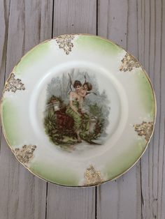 Excited to share this item from my shop: Hand Painted Antique Dessert Plate Z. Bavaria Porcelain Plate Woman And Cherub Hand Painted Plates, Decorative Plates, Vintage Canisters, Coaster Furniture, Flower Plates, Cake Plates, Serving Platters, Bavaria, Cherub