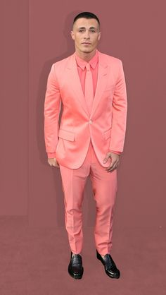 """Colton Haynes brightened up the red carpet of San Andreas when he arrived in a bright pink suit from Marc Jacobs.  """"He had actually saved this look from Style.com as an idea for the premiere, unbeknownst to me,"""" his stylist, Sean Knight told Yahoo Style.  """"My instinct was to go with the pink dress shirt and tie.  """"It's probably best to stay away from anything too drab, like brown, khaki, beige,"""" says Knight."""