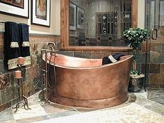 Oval Copper Bath-tub. Copper has healing attributes, this tub is not only pretty but healthy too.