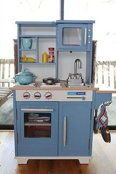 I like that the back of the shelves on the top part are a different color than the rest of the kitchen.  It breaks up the blue a bit.  On our play kitchen we could do cream, light tan, or maybe very light yellow.
