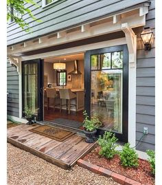 You saw the front door inspiration last week.... The back door for my clients home on the river. I live the black door with white trim, double wide opening and functionality for big family parties on the riverfront.   Would love to know the original owner of this pic!!