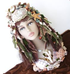 """This one was called """"Earth Goddess"""" and had shells, mosses etc.  Sold but you can find other busts by Sandi Johnston at www.sandisshellscapes.etsy.com"""