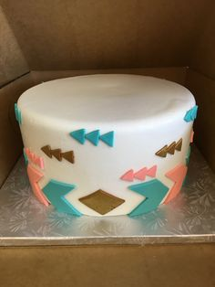 Teal, pink, and brown arrow cake