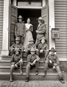 Den Mother: Boy Scouts, 1913. Our thrifty Scouts again, with the postmistress seen here yesterday. Harris & Ewing Collection glass negative.