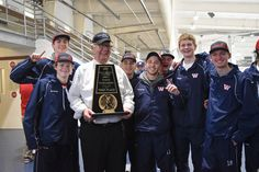 Driver George Lewis celebrates with State Champion Hockey Team Waterloo Warriors.
