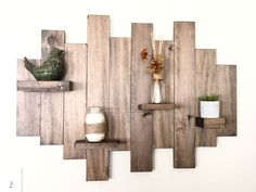 This is a hand made, rustic floating shelf. If is made from reclaimed wood and finished with our proprietary stain blend. It features 4 small shelves that are perfect for displaying your most treasure