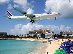 Low landing over Maho Beach, St. Maarten. One of the most challenging approaches in the world for pilots.