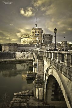 """Roma,Castel Sant'Angelo-It was Used as shelter for popes and as jail. To make it safer in 1277 it was joined to the Vatican by the famous """"Passetto"""". This long fortified passageway allowed the pope to walk safely from the Vatican to Castel Sant'Angelo. Today it is a Museum (National Museum in Castel Sant'Angelo). There are collections of weapons and documents about the history of the castle. Lazio"""
