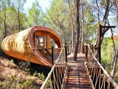 Fibonacci Treehouse, inspired by the Fibonacci spiral. By British firm Blue Forest.  Article: http://www.treehugger.com/green-architecture/blue-forest-fibonacci-tree-house.html. Fibonacci spiral: https://en.wikipedia.org/wiki/Fibonacci_number.