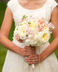 This bouquet of pale peonies, Juliet and Patience garden roses, Femma and Creme de la Creme roses, spray roses, freesia, sweet peas, and ranunculus would be perfect for an early summer celebration.
