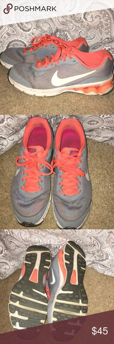 Nike Sneakers Nike brand sneakers in great condition. Grey and orange. Some marks here and there from light wear but nothing super noticeable Nike Shoes Athletic Shoes