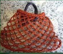 Kete kupenga (fishermans knot) woven Maori kete.