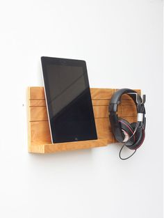 THE DESIGN  Head Jack Ear Rack iPad Wall Mount  Head Jack Ear Rack is our handcrafted, wooden headphone and iPhone, tablet or iPad wall