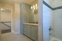 Loads of bathroom storage from Vujovich Design Build in Minneapolis (featured on House of Turquoise blog)