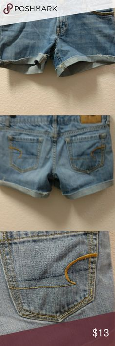 American Eagle blue jean shorts, (not homemade) American Eagle shorts. Great on. 5 pockets. Signature button. Double stitching American Eagle Outfitters Shorts Jean Shorts