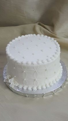 The Cakebox Bahamas: Buttercream finished wedding cake with top and side impressions and pearl dragees.