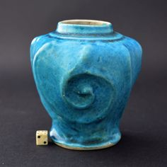 An unusual 16th century Ming porcelain jar. This small rare turquoise biscuit glazed Ming porcelain baluster shaped jar has ogee moulding and one centre.