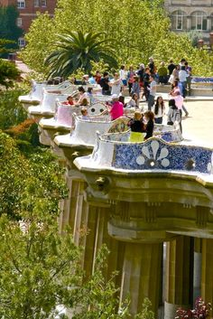 My mom says she sat on every spot at the Parc Guell Growing up in Barcelona Spain . Love it