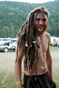 Long dreadlocks, natural, beads, hippie guy