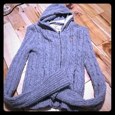 Hollister Sweater Hollister Sweater. Still has lots of wear to it but you can tell it has been washed and worn. Still good condition though. Get this 50 dollar sweater at a terrific price! Hollister Sweaters Cardigans