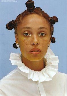 freckles and bantu knots...what a unique beatuy