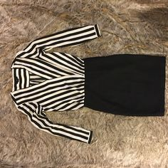 H&M stripped dress White and Black H&M dress. Made to look like a skirt and blouse set. Offers welcomed. H&M Dresses