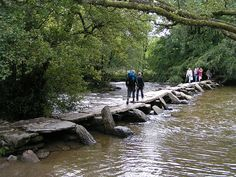 An ancient clapper bridge at Tarr Steps, Exmoor, Somerset, England which possibly dates to around 1000 BC
