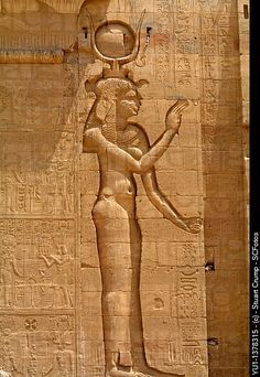 Goddess Isis shown in relief carving at Philae Temple, Aswan, Egypt.