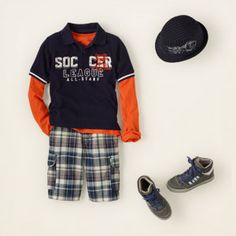 your soccer star will love this graphic polo - it looks great with a bright layer underneath, or all by itself. we add plaid cargo shorts and boyish accessories for the perfect finishing touches.