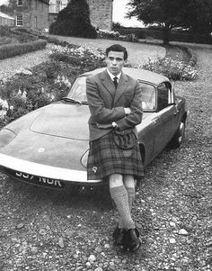 Jim Clark, Formula 1 world champion in 1963 and 1965, with his Lotus Elan road car.