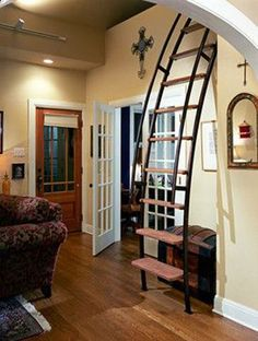 This ladder has been sloped to make climbing easier; it is more like a stair-ladder hybrid. This creates a minimal and very practical option in a small space. | Tiny Homes