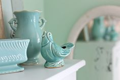 Blue pottery vases..love the way they look...and reflected in the mirror!