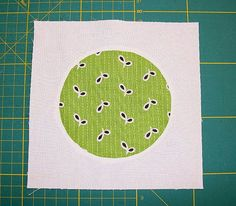 Sew a perfect inset circle. I used this technique when I made my love beads baby quilts and it worked like a charm.