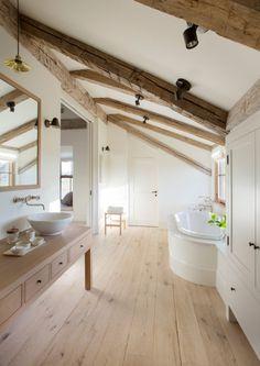 Bright and rustic attic bathroom