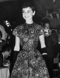 Audrey Hepburn at a fashion show in Amsterdam, November 1954.