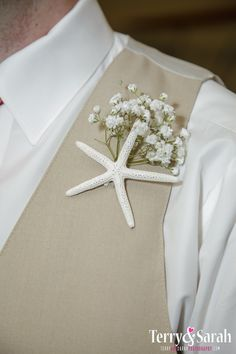 Baby's breath and starfish boutonniere.