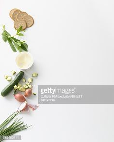 Stock Photo : Still life food selection of zucchini, cream and digestive biscuits