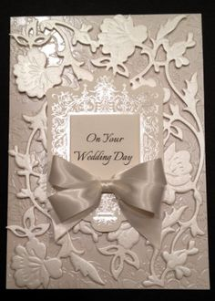 https://www.etsy.com/listing/186614618/fancy-ivory-floral-wedding-card-with?ref=shop_home_active_23