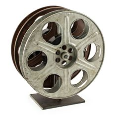 Vintage Film Reel Wine Rack  $375.00  Roll camera! Classic Hollywood comes to life in a scene stealing wine rack—repurposed midcentury film reels make the perfect modern wine rack; classic film nostalgia for celluloid and sauvignon blanc lovers alike. For added delight—each reel is wound with a vintage MGM movie ... the name of the actual film identified on its base. Authentic, unique, absolutely a star. #vintage #FathersDay #bambecoChic