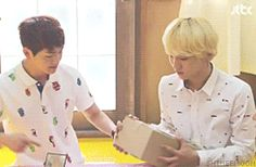 Onew (SHInee) busting through a cardboard box with his finger.  I'm beginning to wonder if he isn't actually an android...  (.gif)