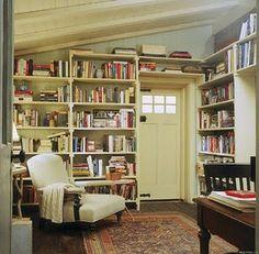 bookcases around door at a corner